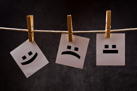 Emoticons on note paper attched to rope with clothes pins