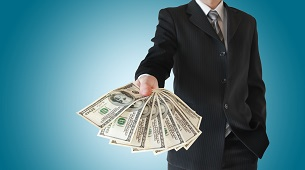 Man in  black suit offers money isolated on blue background.